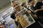 John Cameron Mitchell holds a copy of Just Out featuring him. Just one of many memorable JO covers over the years