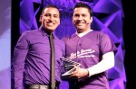 Task Force Deputy Executive Director of External Relations Russell Roybal presents Ernesto Dominguez with the Youth Leadership Award.